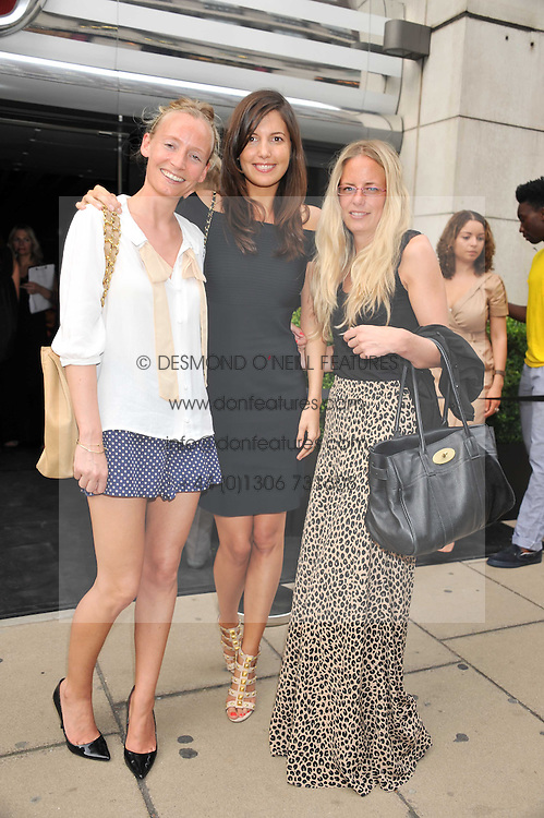 Left to right, MARTHA WARD, AMANDA SHEPPARD and ASTRID HARBORD at a party to launch the Gucci designed Fiat 500 customized by Gucci Creative Director Frida Giannini in collaboration with FIAT's Centro Stile, held at Fiat, 105 Wigmore Street, London on 27th June 2011.