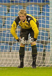 PODGORICA, MONTENEGRO - Wednesday, August 12, 2009: Wales' goalkeeper Wayne Hennessey looks dejected after Montenegro score the opening goal from the penalty spot during an international friendly match at the Gradski Stadion. (Photo by David Rawcliffe/Propaganda)