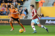 Burnley midfielder Joey Barton on the ball watched by Wolverhampton Wanderers midfielder Dave Edwards during the Sky Bet Championship match between Wolverhampton Wanderers and Burnley at Molineux, Wolverhampton, England on 7 November 2015. Photo by Alan Franklin.