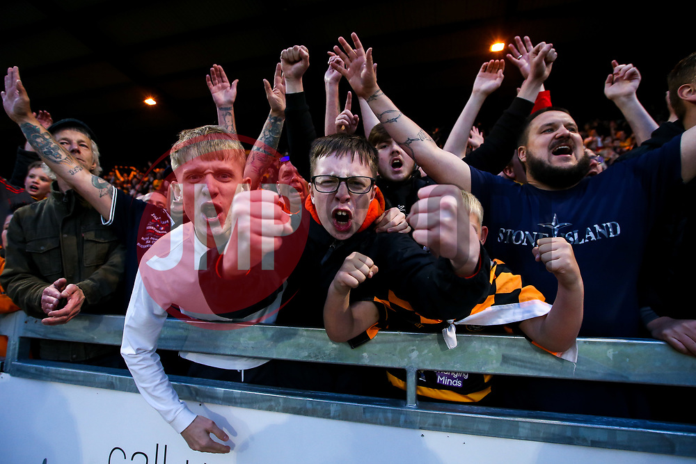 Newport County fans celebrate after winning through to the Sky Bet League Two Playoff Final - Mandatory by-line: Robbie Stephenson/JMP - 12/05/2019 - FOOTBALL - One Call Stadium - Mansfield, England - Mansfield Town v Newport County - Sky Bet League Two Play-Off Semi-Final 2nd Leg