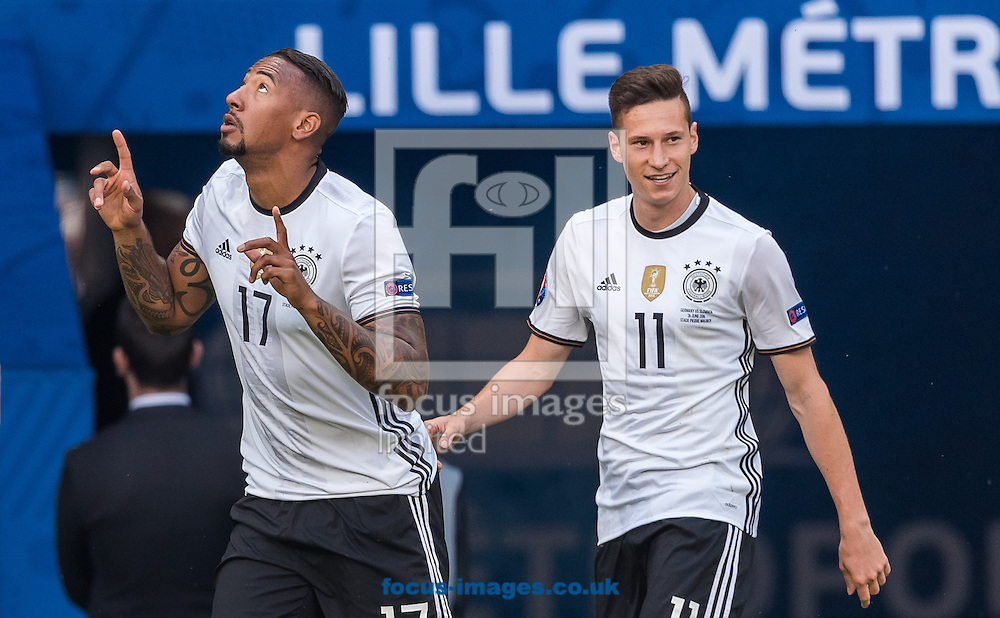 Jerome Boateng of Germany celebrates with team mate Julian Draxler (right) after scoring the first goal during the UEFA Euro 2016 match at Stade Pierre-Mauroy, Lille, France.<br /> Picture by EXPA Pictures/Focus Images Ltd 07814482222<br /> 26/06/2016<br /> *** UK &amp; IRELAND ONLY ***<br /> EXPA-FEI-160626-5236.jpg