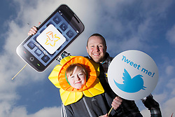 Repro Free: 'APPY DAYS'  Today well known comedian, PJ Gallagher, with little helper Gareth Slevin (age 9) 'download' the first ever Daffodil Day app in advance of the Irish Cancer Society's 26th Daffodil Day, supported by Dell, which is taking place on Friday 22nd March. This exciting innovation has been developed by Dell employees in collaboration with the Irish Cancer Society. As the lead partner for Daffodil Day, this will be the third year that Dell will support the annual campaign. The aim of the App is to expand the reach of the campaign even further, and to make it easier for people to donate and get information about Daffodil Day. The app is available to download free from today in all mobile phone app stores. .Daffodil Day aims to raise ?3.4million for cancer information, care and support services around the country and appeal for volunteers to get involved. Visit www.cancer.ie   or CallSave 1850 60 60 60 to organise, volunteer or donate. Picture Andres Poveda
