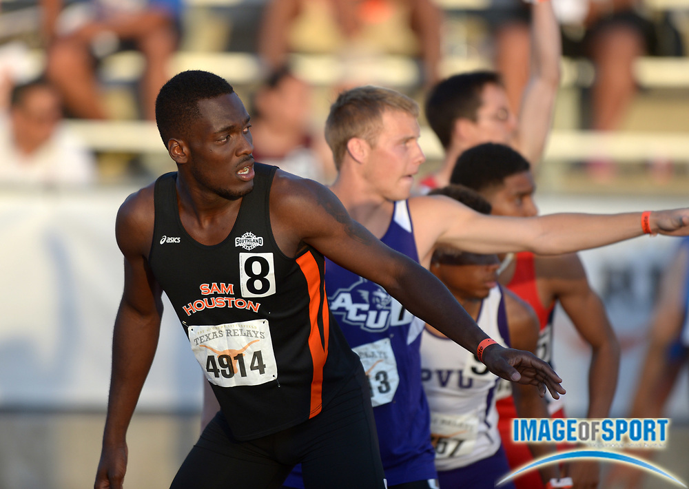 Mar 28, 2014; Austin, TX, USA; De'Quad Binder of Sam Houston State awaits the handoff on the 800m anchor of the sprint medley relay in the 87th Clyde Littlefield Texas Relays at Mike A. Myers Stadium.
