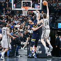 02 April 2017: San Antonio Spurs center Pau Gasol (16) goes for the baby hook over Utah Jazz center Rudy Gobert (27) during the San Antonio Spurs 109-103 victory over the Utah Jazz, at the AT&T Center, San Antonio, Texas, USA.