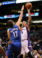 Dec. 09, 2012; Phoenix, AZ, USA; Phoenix Suns forward Michael Beasley (0) puts up the ball during the game against the Orlando Magic forward Josh McRoberts (17) in the second half at US Airways Center. The Magic defeated the Suns 98-90. Mandatory Credit: Jennifer Stewart-USA TODAY Sports