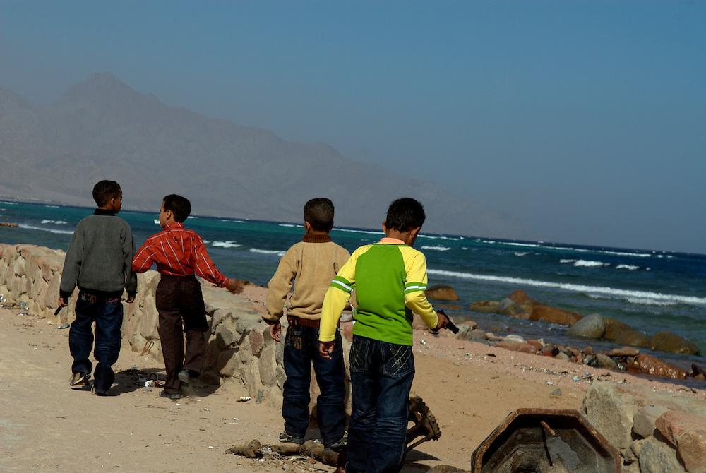 Egypt, Dahab. December/08/2008...Young boys patroling the Dahab beachfront...
