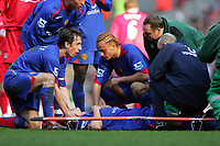 Gary Neville and Wes Brown comfort the injured Alan Smith as he lies in agony after Dislocating his Left Ankle<br />
