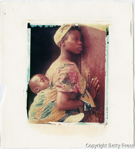 Mother and child waiting to enter a health clinic.<br />