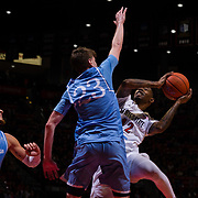 05 December 2018: San Diego State Aztecs guard Jeremy Hemsley (42) takes an running off balance jump shot with San Diego Toreros guard Finn Sullivan (23) in his face in the second half. The Aztecs lost to the Toreros 73-61 at Viejas Arena.