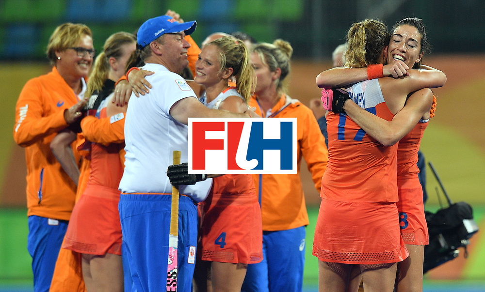 Netherland's Naomi van As (R) celebrates with teammates after winning the women's quarterfinal field hockey Netherlands vs Argentina match of the Rio 2016 Olympics Games at the Olympic Hockey Centre in Rio de Janeiro on August 15, 2016.  / AFP / Carl DE SOUZA        (Photo credit should read CARL DE SOUZA/AFP/Getty Images)