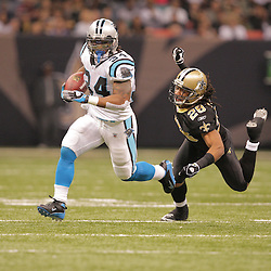 2008 December, 28: Carolina Panthers running back DeAngelo Williams (34) runs away from New Orleans Saints cornerback Usama Young (28) during a week 17 game between NFC South divisional rivals the Carolina Panthers and the New Orleans Saints at the Louisiana Superdome in New Orleans, LA.