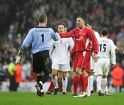 LIVERPOOL, ENGLAND - SUNDAY MARCH 27th 2005: Liverpool Legends' John Aldridge shakes hands with Celebrity XI's Paul Harrison during the Tsunami Soccer Aid match at Anfield. (Pic by David Rawcliffe/Propaganda)