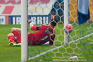Richard O'Donnell of Wigan Athletic fumbles the ball in to his own net for the opening goal during the FA Cup match at Gigg Lane, Bury<br /> Picture by Matt Wilkinson/Focus Images Ltd 07814 960751<br /> 07/11/2015