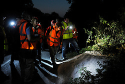 © Licensed to London News Pictures. 03/09/2013. Eldersfield, Gloucestershire, UK. Wounded Badger Patrol patrol in Gloucestershire check badger setts.  Around 100 people patrolled local roads and public footpaths looking for injured badgers from the badger cull which has now started in West Gloucestershire.  Police were also patrolling but there were no arrests.  03 September 2013.<br /> Photo credit : Simon Chapman/LNP