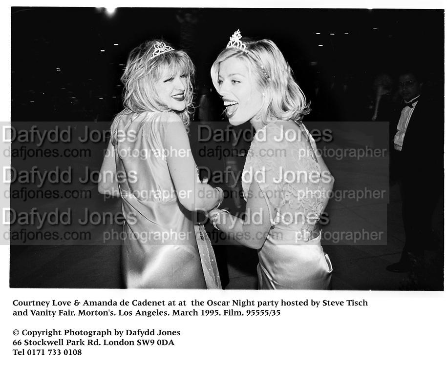 Courtney Love &amp; Amanda de Cadenet at at  the Oscar Night party hosted by Steve Tisch and Vanity Fair. Morton's. Los Angeles. March 1995. Film. 95555/35<br /> &copy; Copyright Photograph by Dafydd Jones<br /> 66 Stockwell Park Rd. London SW9 0DA<br /> Tel 0171 733 0108