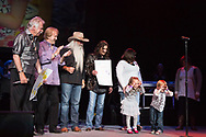 Cora and Salis present the The Oak Ridge Boys a large card made by students at the  Sugar Grove Developmental Day School.