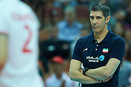 Iran's trainer coach Slobodan Kovac looks to the ball while volleyball match between Germany and Iran during the 2014 FIVB Volleyball World Championships at Spodek Hall in Katowice on September 17, 2014.<br /> <br /> Poland, Katowice, September 17, 2014<br /> <br /> For editorial use only. Any commercial or promotional use requires permission.<br /> <br /> Mandatory credit:<br /> Photo by © Adam Nurkiewicz / Mediasport