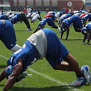 New York Giants players warm up with stretches before the start of training during the 2013 New York Giants Training Camp at the Quest Diagnostics Training Centre, East Rutherford, New Jersey, USA. 29th July 2013. Photo Tim Clayton.