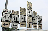 Abundance of higway marker signs point all directions on exiting Monroeville, Alabama.