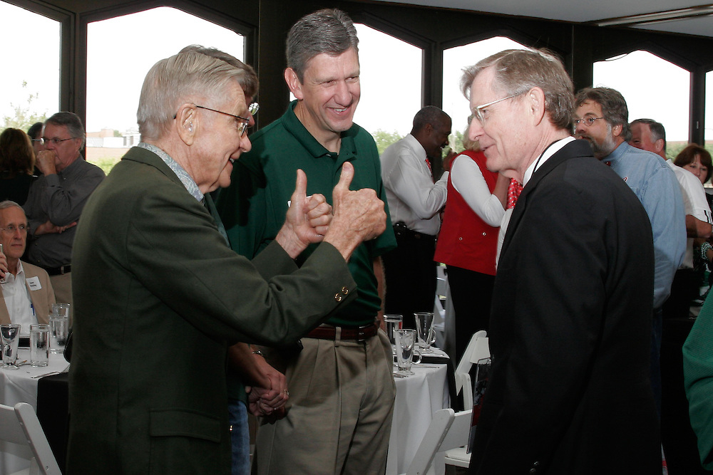 Vern Alden gives a thumbs up to Ohio State's President E.Gordon Gee in reference to their years at Brown University. In the center is Ohio University's Jim Schaus, Director of Atheletics. The pre-football game brunch at Drake Center at Ohio State University Saturday September 6, 2008. In attendance included, alumni, the OSU President E. Gordon Gee, OU President Dr. Roderick McDavis, Vern Alden, Ohio Governor Ted Strickland  and U.S. Senator George Voinovich (R-OH).  (Christina Paolucci)