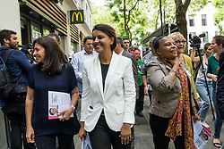June 14, 2017 - Villeurbanne, Paris, France - Former French Education Minister and candidate for the France's Socialist political party (PS) for the legislative elections in Villeurbanne, Najat Vallaud-Belkacem (C) walks next to former Justice Minister Christiane Taubira (R) and mayor of Paris Anne Hidalgo (L) as she campaigns in a street of Villeurbanne, on June 14, 2017. The second round of the French legislative elections will take place on June 18, 2017. (Credit Image: © Nicolas Liponne/NurPhoto via ZUMA Press)