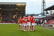 The Barnsley FC players celebrating their team's second goal during the EFL Sky Bet Championship match between Barnsley and Queens Park Rangers at Oakwell, Barnsley, England on 14 December 2019.