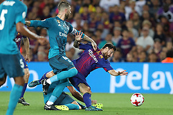 August 13, 2017 - Barcelona, Spain - Lionel Messi of FC Barcelona is tackled by Sergio Ramos of Real Madrid during the Spanish Super Cup football match between FC Barcelona and Real Madrid on August 13, 2017 at Camp Nou stadium in Barcelona, Spain. (Credit Image: © Manuel Blondeau via ZUMA Wire)