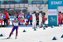 BATMUNKH Ganbold MGL LW6 competing in the ParaSkiDeFond, Para Nordic Skiing, 20km at  the PyeongChang2018 Winter Paralympic Games, South Korea.