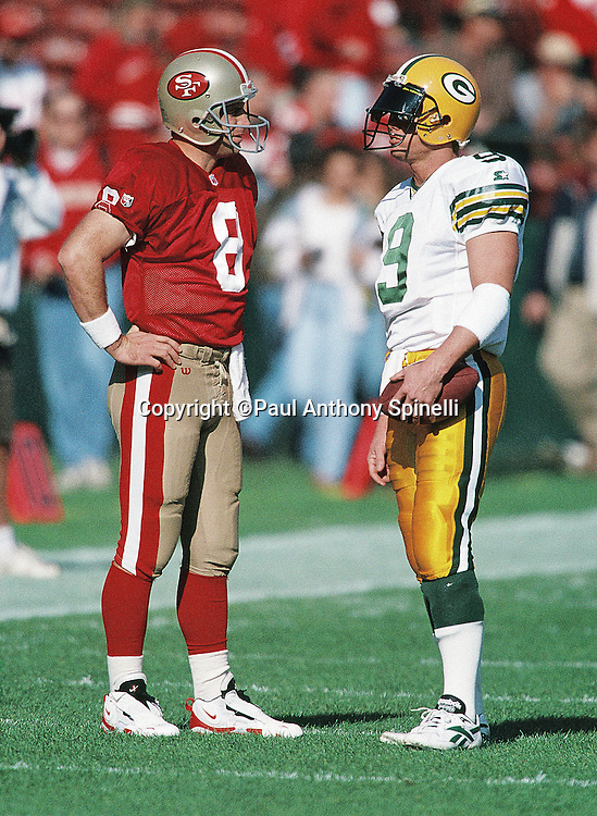 San Francisco 49ers quarterback Steve Young (8) talks to Green Bay Packers quarterback Jim McMahon (9) before the NFL NFC Divisional Playoff football game against the Green Bay Packers on Jan. 6, 1996 in San Francisco. The Packers won the game 27-17. (©Paul Anthony Spinelli)