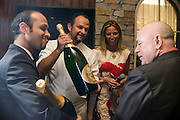Photo by Matt Roth<br /> Assignment ID: 30148071A<br /> <br /> Two methusalems of Perrier-Jouet were presented as gifts to wedding couple David Hagedorn, right, and Michael Widomski, from Fiola's owner, Chef Fabio Trabocchi, middle-left, and his wife Maria Trabocchi, middle-right, Sunday, September 22, 2013. Fiola employee Farhal Haq, right, holds the second six-liter bottle.