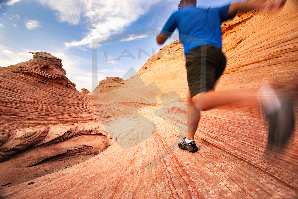 trail running in the sandstone hoodoo landscape of glen canyon national recreation area, utah/arizona.