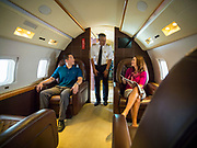 A male model serving as the Captain of this corporate jet greets his passengers.  Advertising commissioned for Phillips 66 Aviation Fuels.<br /> <br /> Created by aviation photographer John Slemp of Aerographs Aviation Photography. Clients include Goodyear Aviation Tires, Phillips 66 Aviation Fuels, Smithsonian Air & Space magazine, and The Lindbergh Foundation.  Specialising in high end commercial aviation photography and the supply of aviation stock photography for advertising, corporate, and editorial use.