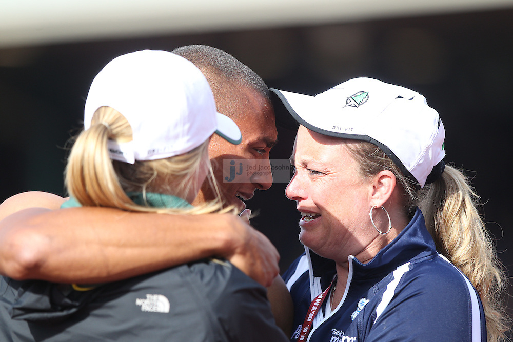 Ashton Eaton, center, greets his mother, Rosyln Eaton, right, and his fiancee Brianne Theisen, left, after crossing the finish line in the 1500-meter to set a world record in the decathlon during day 2 of the U.S. Olympic Trials for Track & Field at Hayward Field in Eugene, Oregon, USA 23 Jun 2012..(Jed Jacobsohn/for The New York Times)....