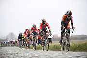 Belgium, February 26 2017:  Riders on the Oude Kwaremont climb during the 2017 edition of the Elite men's Kuurne Brussels Kuurne race. Copyright 2017 Peter Horrell.