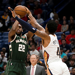 Mar 12, 2019; New Orleans, LA, USA; Milwaukee Bucks forward Khris Middleton (22) shoots over New Orleans Pelicans guard Elfrid Payton (4) during the second half at the Smoothie King Center. Mandatory Credit: Derick E. Hingle-USA TODAY Sports