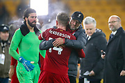 Liverpool Manager Jürgen Klopp celebrates with Liverpool midfielder Jordan Henderson (14) at full time during the Premier League match between Wolverhampton Wanderers and Liverpool at Molineux, Wolverhampton, England on 23 January 2020.