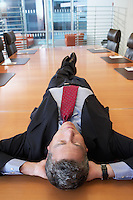 Businessman lying on conference table