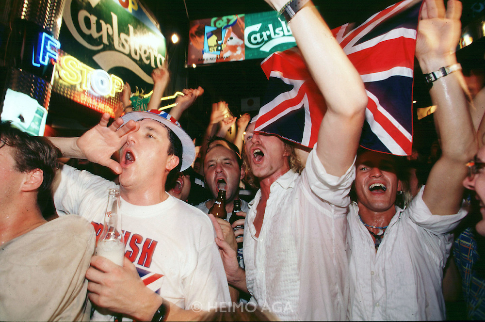 Handover Night. (Mainly Western) youth celebrating in Lan Kwai Fong with Union Jacks.