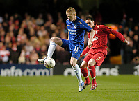 Photo: Leigh Quinnell.<br /> Chelsea v Liverpool. UEFA Champions League. <br /> 06/12/2005. Chelseas Damien Duff keeps the ball while under presure from Liverpools  Steve Finnan.