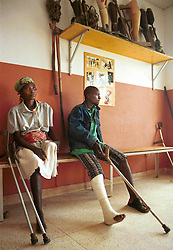 Angolans wait to see a doctor at the International Red Cross hospital in Huambo, Angola. Hundreds of thousands of Angolans have lost limbs after stepping on a mine and in some towns one-in-four people have lost a limb or have been killed by mines. Despite a huge campaign to educate Angolans of the danger, most are forced to search the countryside for food despite the risk. .(Photo by Ami Vitale)