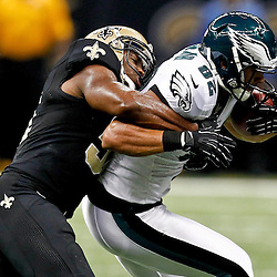 November 5, 2012; New Orleans, LA, USA; New Orleans Saints linebacker Jonathan Vilma (51) tackles Philadelphia Eagles tight end Clay Harbor (82) during the first half of a game at the Mercedes-Benz Superdome. Mandatory Credit: Derick E. Hingle-US PRESSWIRE