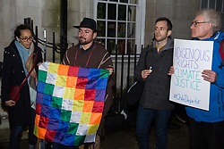 London, UK. 6 December, 2019. Sergio Cubillos (c), the President of the Atacameños Peoples Council in Chile, addresses activists from groups including the Campaign Against Climate Change, the Chilean Assembly in London, Medact, Biofuelwatch and UK Student Climate Network holding a vigil outside the Chilean embassy in solidarity with the people of Chile following the transfer of UN climate negotiations from Santiago to Madrid with the consequent effect of marginalising the voices of activists and communities from the Global South.