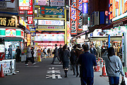 a shopping street near Shinjuku station after dark
