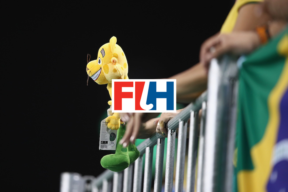 RIO DE JANEIRO, BRAZIL - AUGUST 07:  A Brazil supporter in the crowd holding a mascot watches on during the men's pool A match between Brazil and Belgium on Day 2 of the Rio 2016 Olympic Games at the Olympic Hockey Centre on August 7, 2016 in Rio de Janeiro, Brazil.  (Photo by Mark Kolbe/Getty Images)