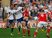 Stewart Downing of Middlesbrough  and Brad Potts of Barnsley  contest a loose ball  during the EFL Sky Bet Championship match between Barnsley and Middlesbrough at Oakwell, Barnsley, England on 14 October 2017. Photo by Paul Thompson.