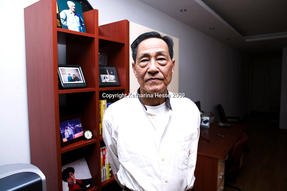 BEIJING, MAY-15, 2009: Former senior Chinese official Bao Tong , who spent seven years in prison for sympathizing with democracy advocates, with a picture of his mentor Zhao Ziyang  ( top left ) in his apartment in Beijing.