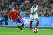 England Forward Raheem Sterling takes the ball past Spain midfielder Juan Mata during the International Friendly match between England and Spain at Wembley Stadium, London, England on 15 November 2016. Photo by Mark Davies.