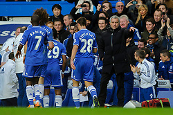 Jose Mourinho (POR), seeking his 100th Barclays Premier League win as Chelsea manager, looks focussed as Forward Samuel Eto'o (CMR) rushes over to celebrate his sides opening goal during the match - Photo mandatory by-line: Rogan Thomson/JMP - Tel: 07966 386802 - 19/01/2014 - SPORT - FOOTBALL - Stamford Bridge, London - Chelsea v Manchester United - Barclays Premier League.