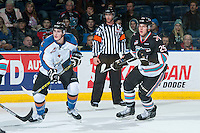 KELOWNA, CANADA - DECEMBER 2: Austin Wellsby #17 of Kootenay Ice skates beside Cal Foote #25 of Kelowna Rockets on December 2, 2015 at Prospera Place in Kelowna, British Columbia, Canada.  (Photo by Marissa Baecker/Shoot the Breeze)  *** Local Caption *** Austin Wellsby; Cal Foote;