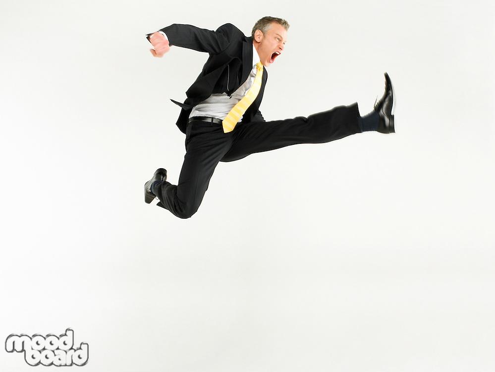 Business man jumping full length